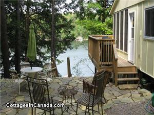 Side of cottage, flagstone patio, deck, BBQ