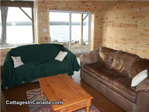 Big family room in the lower Level with Satellite TV with Internet. Walks right out to the lake.