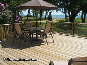 Large Deck looking over lake, table&6chairs, BBQ