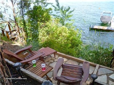 Lake front cottage with boat lift on Okanagan Lake