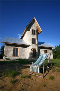 Rosa in SOlisterra's Eco-strawbale Cottage located directly on beautiful sandy beach