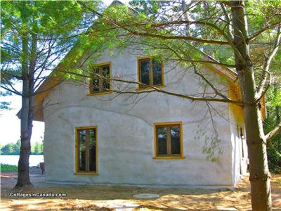 Very eco-cottage solar powered strawbale - Pinea of SOlisterra - directly on its own sandy beach