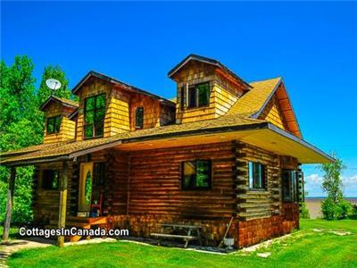 Lakefront Loghouse on 5 acres in Traverse Bay, MB near Victoria Beach with YEAR ROUND HOT TUB