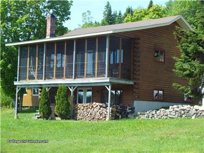 Mechanic Lake Lodge, Year round log home with Wood stove and a glass door, pet friendly.