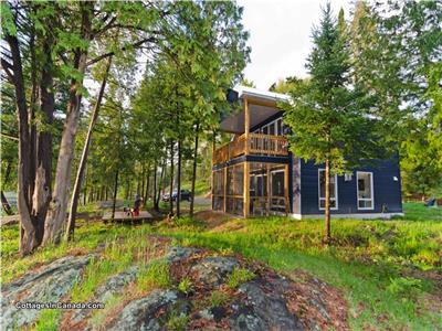 Ultimate Privacy Lakefront Cottage/House with Approx. 19 Acres