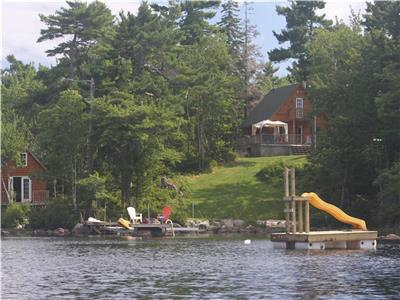 Very private Lake front, new log cottage! 35 min from Halifax. Renting all year! Email for Rates!