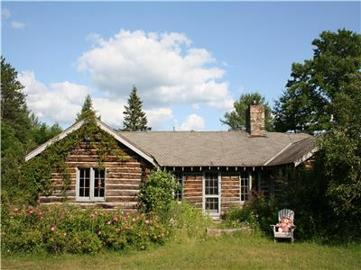 Private 130 acre Larson Lake Dear Old Rustic Log Cottage, Modest Modern Conveniences Private beach