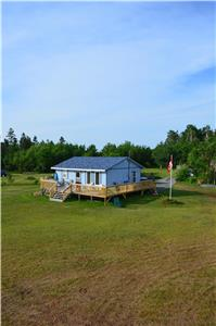 Private Oceanfront Cottage with 200 feet beach front on 1.5 acres