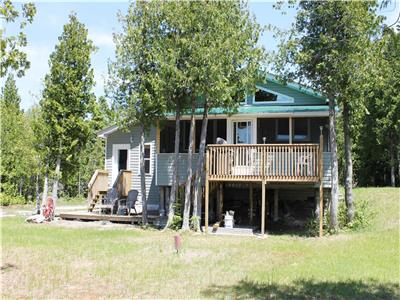 Newly built on beautiful Lake Huron on Manitoulin Island! Located in Spring Bay on a 1.84 Acre Lot!
