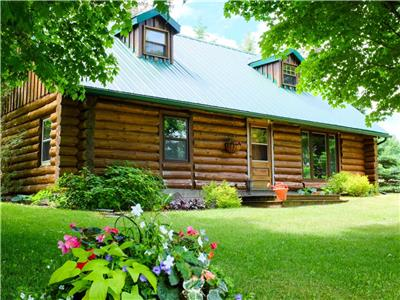 Prince Edward Bay Cottage - a private log home experience on 7 acres with 250 ft of water front