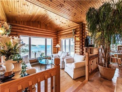 Beautiful Waterfront Log Home with wrap around deck with amazing views of the Atlantic Ocean