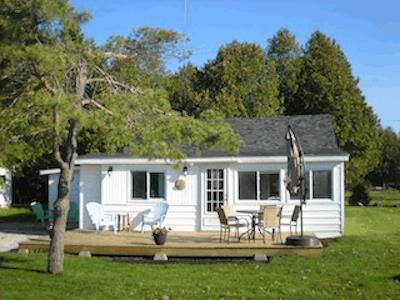 A cute little cottage directly across from a shallow ,warm beach. Rents by the week July and August