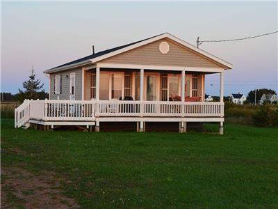 Clean, bright, beach side vacation @ The Twins' Cottages Limited