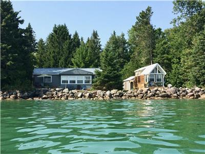 Beautiful Lake Ontario waterfront property with 1400 sq ft 4 season cottage and 280 sq ft tiny house