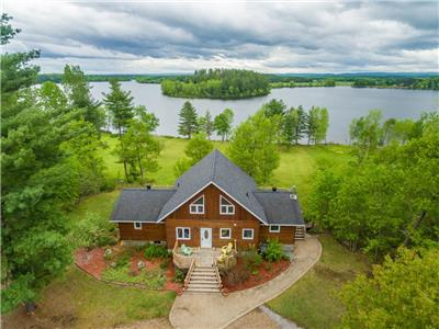 4-Season Property with Breathtaking Riverfront Views