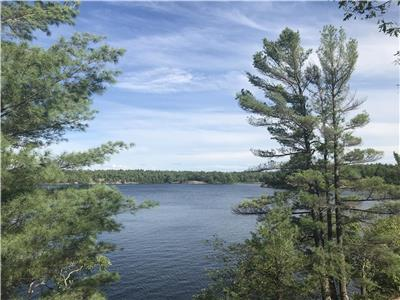 Newly & exquisitely renovated water access cottage on Go Home Lake with 180 degree panoramic views