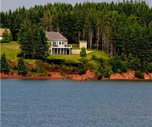 Souris Beach House at water's edge a fully equipped executive vacation rental in PEI, pet friendly
