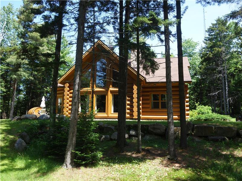 Maison en bois rond chalet 23 chalet à vendre mille isles fs 25165 cottagesincanada